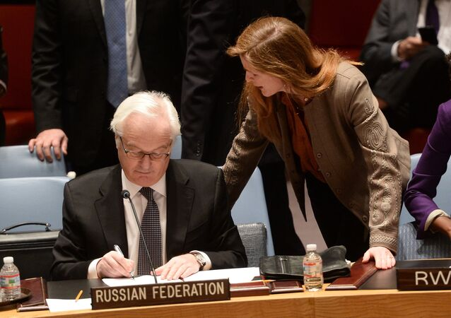 US Ambassador to the UN Samantha Power talks with her Russian counterpart Vitaly Churkin prior to a vote on a resolution on Ukraine during a UN Security Council emergency meeting at United Nations headquarters in New York on March 15, 2014