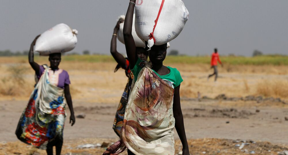 Women carry sacks of food in Nimini village, Unity State, northern South Sudan, February 8, 2017. Picture taken on February 8, 2017.
