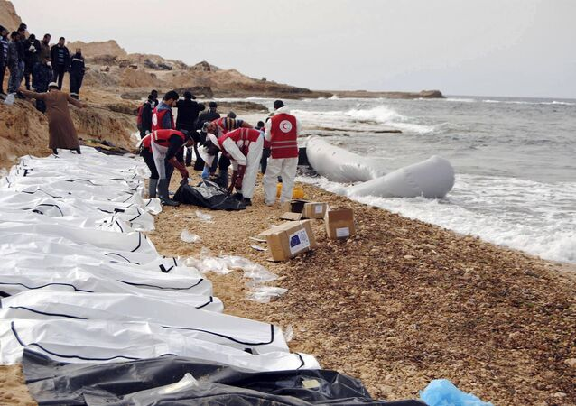 This Monday, Feb. 20, 2017 photo provided by The International Federation of Red Cross and Red Crescent Societies (IFRC), shows the bodies of people that washed ashore and were recovered by the Libyan Red Crescent, near Zawiya, Libya