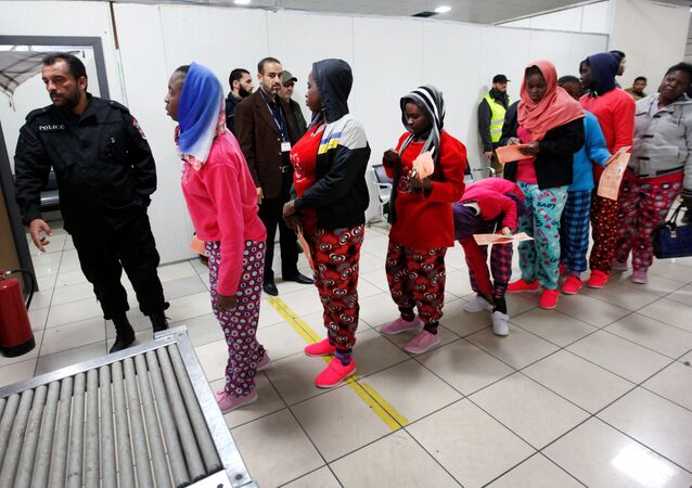 African migrants wait to be deported at Mitiga International Airport, east of Tripoli, Libya, February 14, 2017.
