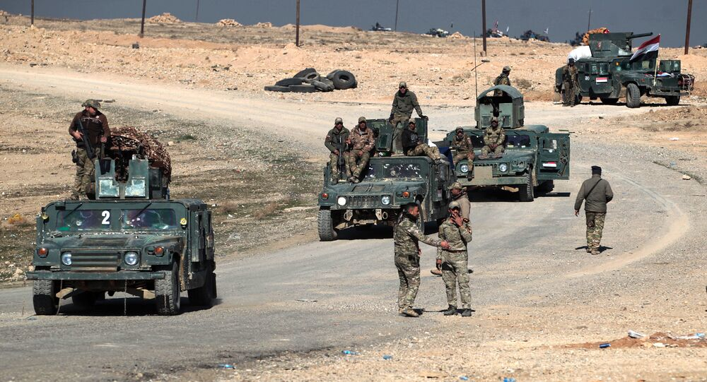 (File) Iraqi security forces drive in the village of al-Buseif, south of Mosul, after they recaptured the village from the control of the Islamic State (IS) group on February 21, 2017, during the ongoing military offensive to retake the western side of Mosul