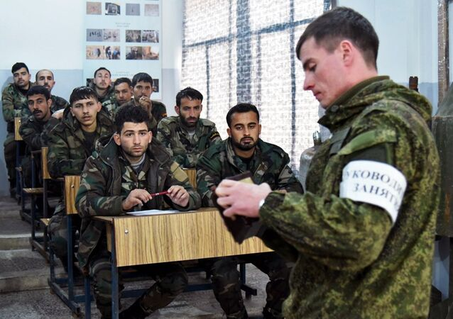 Russian and Syrian servicemen at the Russian Armed Forces' International Mine Action Center in Aleppo