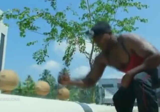 Man smashes 124 coconuts with bare hand in less than a minute