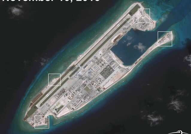 A satellite image shows what CSIS Asia Maritime Transparency Initiative says appears to be anti-aircraft guns and what are likely to be close-in weapons systems (CIWS) on the artificial island Fiery Cross Reef in the South China Sea in this image released on December 13, 2016
