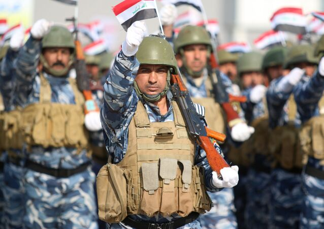 Iraqi policemen march during a ceremony to mark the 95th anniversary of the creation of the Iraqi police at the Shaabiyah training camp in the southern city of Basra on January 9, 2017