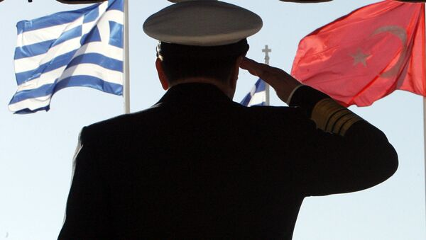 Greece's military Adm. Panagiotis Chinofotis salutes during the Turkish national anthem as the Greek, left, and Turkish flags wave at the Greek Defense Ministry in Athens on Thursday, Nov. 2, 2006 - Sputnik International
