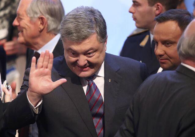 Ukraine President Petro Poroshenko waves next to Polish President Andrzej Duda at the 53rd Munich Security Conference in Munich, Germany, February 17, 2017