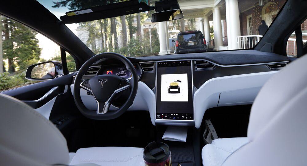 The interior of a Tesla Model X 75D semi-autonomous electric vehicle
