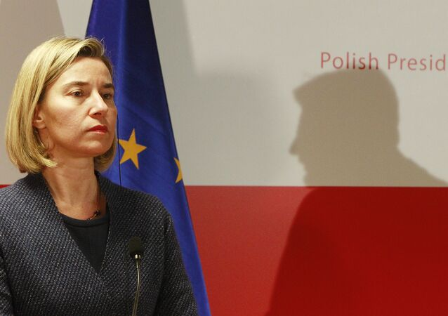 The High Representative of the European Union for Foreign Affairs and Security Policy Federica Mogherini attends a press conference, as the shadow of Poland's Foreign Minister Witold Waszczykowski is seen in the background, after a meeting with foreign ministers of Central and South-Eastern European countries, in Warsaw, Poland, Tuesday, Nov. 29, 2016.