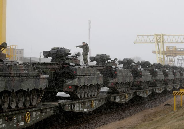 A German army soldier prepares to unload Marder infantry fighting vehicles at the railway station in Sestokai, Lithuania, February 24, 2017
