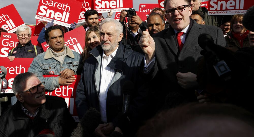 Jeremy Corbyn, the leader of Britain's opposition Labour Party, speaks to supporters after Labour's candidate Gareth Snell (R) won the by-election in Stoke, February 24, 2017.
