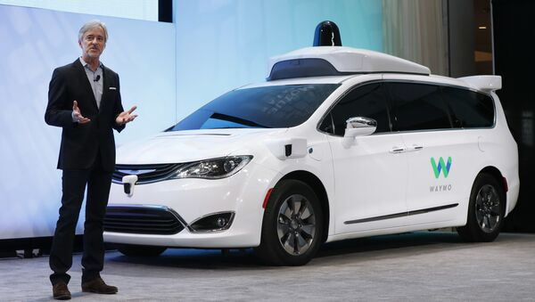 In this Sunday, Jan. 8, 2017, file photo, John Krafcik, CEO of Waymo, the autonomous vehicle company created by Google's parent company, Alphabet, introduces a Chrysler Pacifica hybrid outfitted with Waymo's own suite of sensors and radar, at the North American International Auto Show in Detroit. - Sputnik International