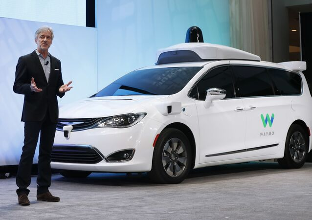 In this Sunday, Jan. 8, 2017, file photo, John Krafcik, CEO of Waymo, the autonomous vehicle company created by Google's parent company, Alphabet, introduces a Chrysler Pacifica hybrid outfitted with Waymo's own suite of sensors and radar, at the North American International Auto Show in Detroit.