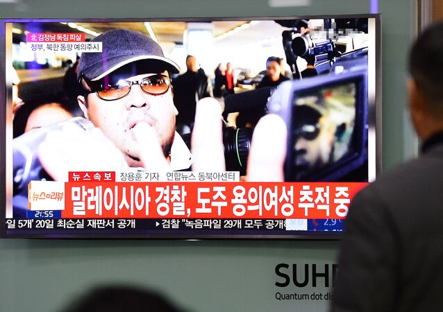 People watch a TV screen broadcasting a news report on the assassination of Kim Jong Nam, the older half brother of the North Korean leader Kim Jong Un, at a railway station in Seoul, South Korea, February 14, 2017.