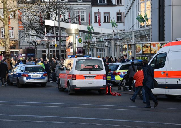Police vehicle and ambulance stand in front of a business building in Heidelberg, western Germany, where a man ploughed into pedestrians