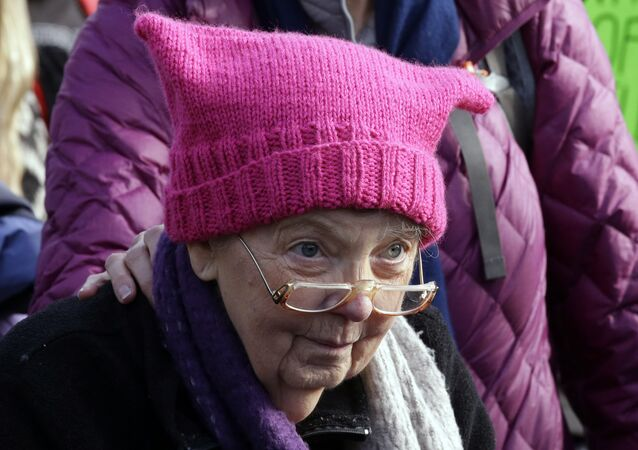 A woman wearing a pink cap marches in a women's march that brought tens of thousands Saturday, Jan. 21, 2017, in Seattle. Women across the Pacific Northwest marched in solidarity with the Women's March on Washington and to send a message in support of women's rights and other causes.
