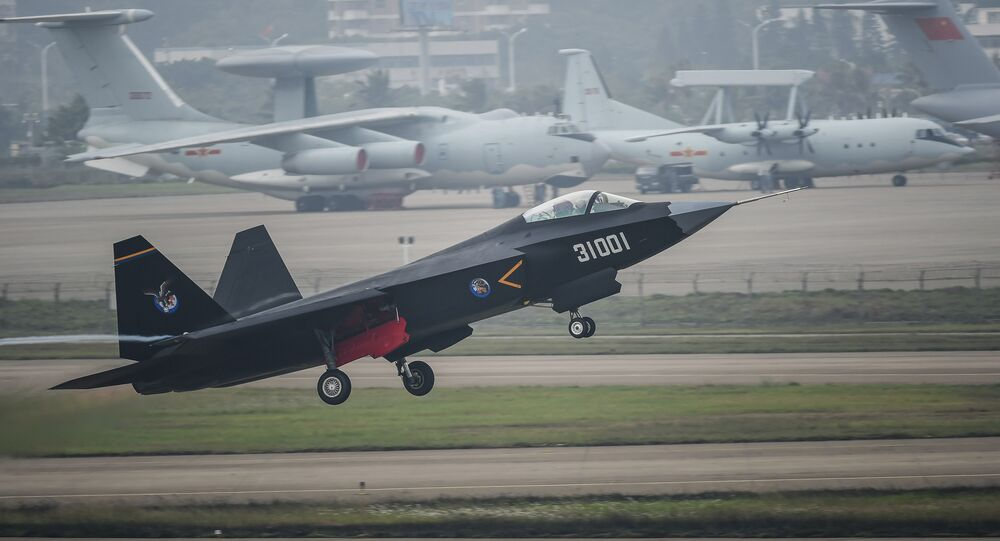 In this photo provided by China's Xinhua News Agency, a J-31 stealth fighter takes off for test flight ahead of the 10th China International Aviation and Aerospace Exhibition in Zhuhai, south China's Guangdong Province, Monday, Nov. 10, 2014.