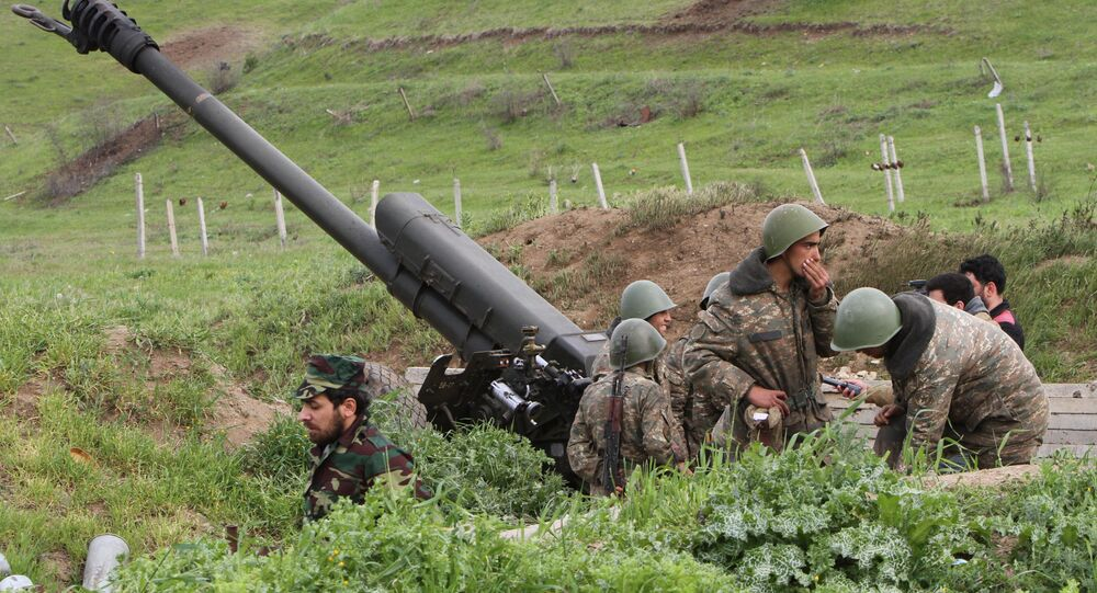 Karabakh Armenian soldiers stand near a howitzer in Hadrut province in Nagorno-Karabakh, Azerbaijan, Tuesday, April 5, 2016. Azerbaijan forces and separatist forces in Nagorno-Karabakh agreed on a cease-fire Tuesday following three days of the heaviest fighting in the region since 1994, the Azeri defense ministry announced.