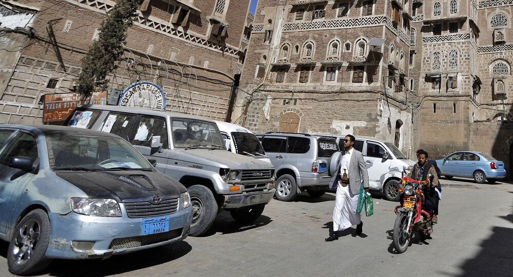 Yemenis walk in the old city of the capital Sanaa