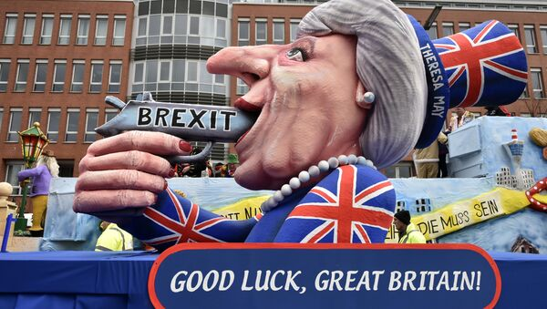 A carnival float depicts British Prime Minister Theresa May with a gun and the writing 'Brexit' on it prior to the traditional carnival parade in Duesseldorf, Germany, on Monday, Feb. 27, 2017. - Sputnik International