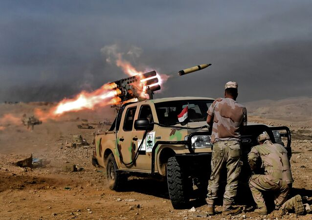 Members of the Iraqi army's 9th Division fire a multiple rocket launcher from a hill in Talul al-Atshana, on the southwestern outskirts of Mosul, on February 27, 2017, during an offensive to retake the city from Daesh fighters