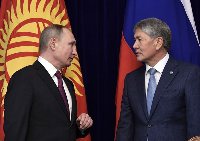 February 28, 2017. Russian President Vladimir Putin and Kyrgyz President Almazbek Atambayev, right, during the signing of joint documents at the Ala Archa residence in Bishkek