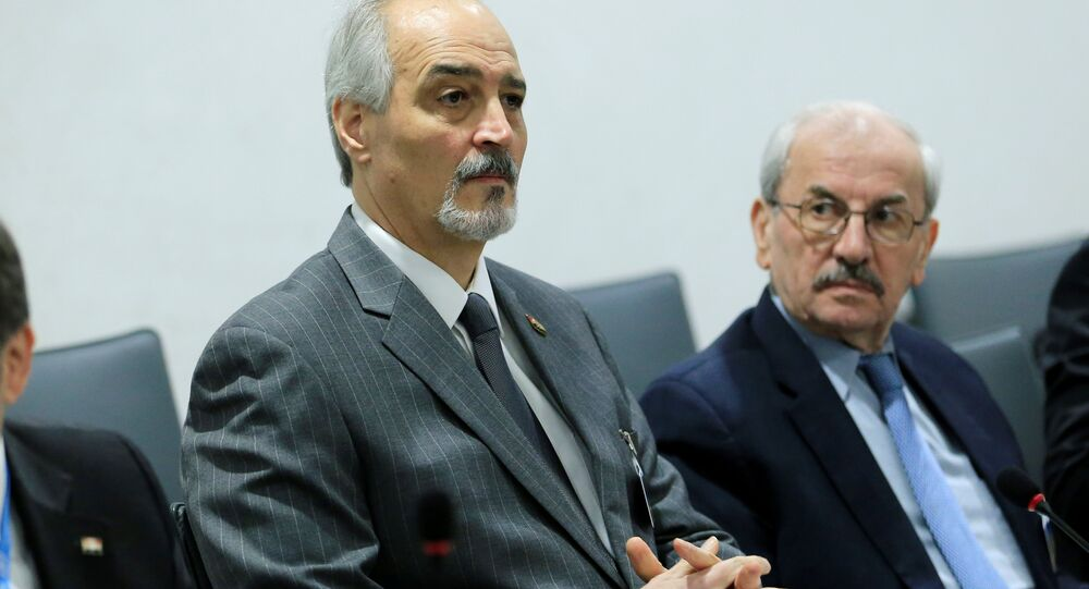 Syrian Ambassador to the U.N. Bashar al Jaafari (L) attends a meeting of Intra-Syria peace talks with UN Special Envoy for Syria Staffan de Mistura at Palais des Nations in Geneva, Switzerland, February 25, 2017