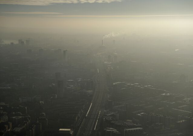 Pollution haze over South East London, through a window in a viewing area of the 95-storey skyscraper The Shard, the tallest building in Britain, in London, Thursday, Jan. 19, 2017
