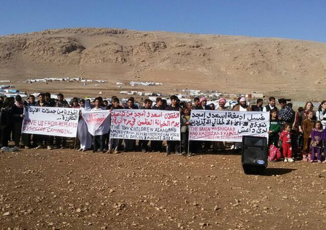 Yazidi rally at a refugee camp n Sinjar Mountains, Iraq