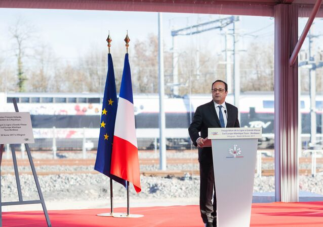 French President Francois Hollande delivers a speech as he attends the inauguration of the new high-speed rail line, linking Tours and Bordeaux, in Villognon, central France.