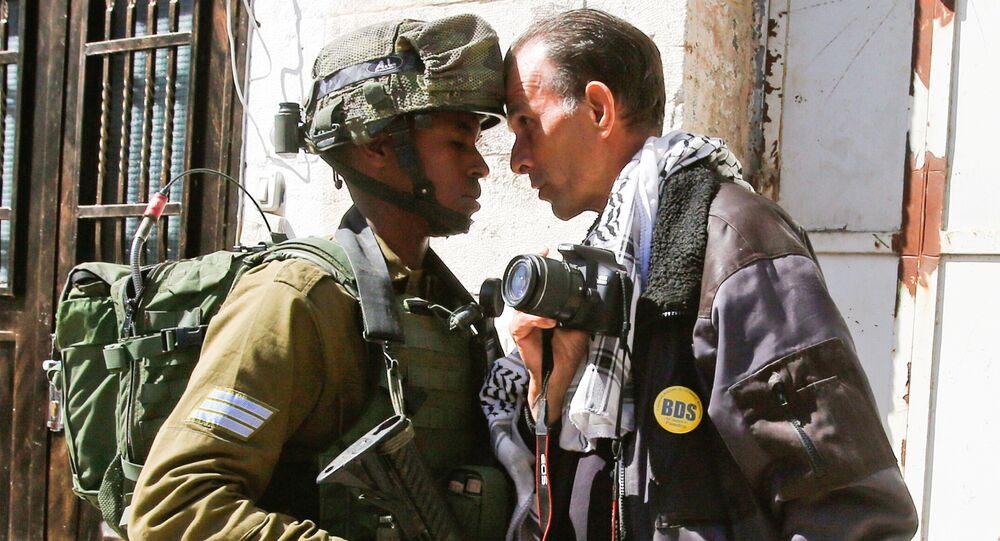 A foreign activist argues with an Israeli soldier during a protest in the West Bank city of Hebron February 24, 2017