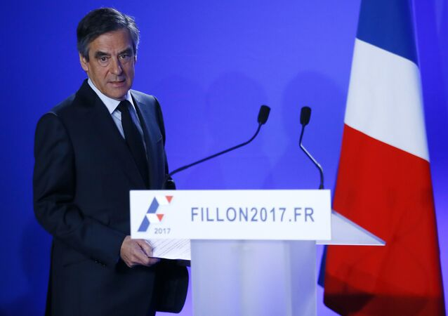 Conservative presidential candidate Francois Fillon arrives to deliver his speech at his campaign headquarters in Paris, Wednesday, March 1, 2017