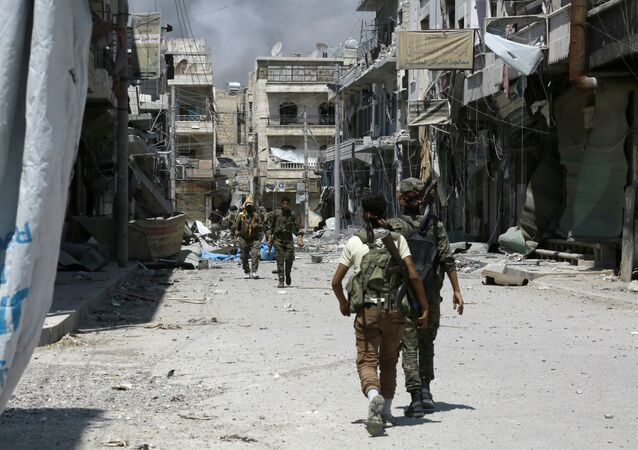 Members of the Syrian Democratic Forces (SDF) patrol a street in the northern Syrian town of Manbij (File)