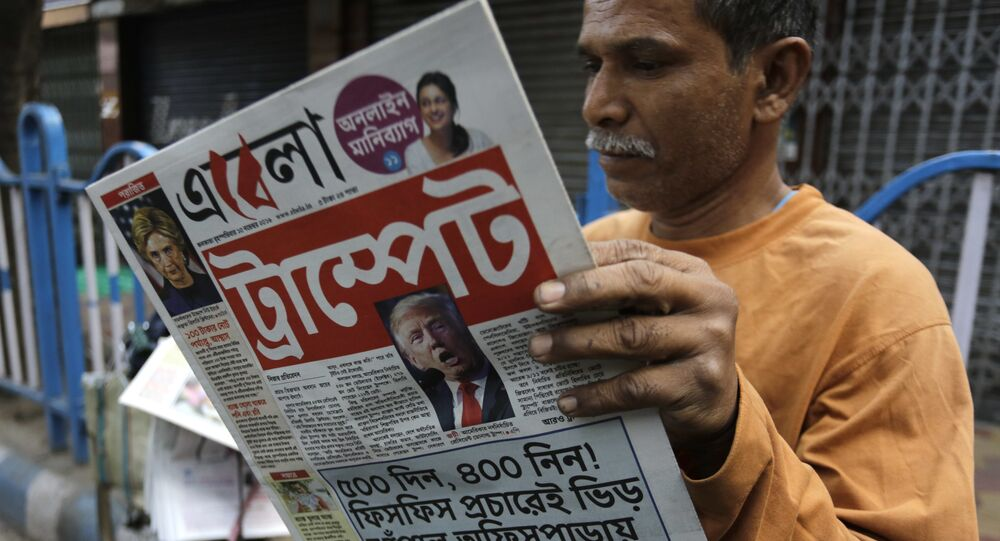 An Indian man reads a Bengali language newspaper that has the words 'Trumped headlined to refer to U.S President-elect Donald Trump's election victory in Kolkata, India, Thursday, Nov. 10, 2016
