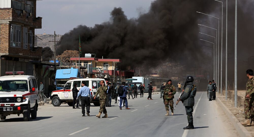 Smoke rises from a district police headquarters after a suicide bombing in Kabul, Afghanistan, Wednesday, March 1, 2017