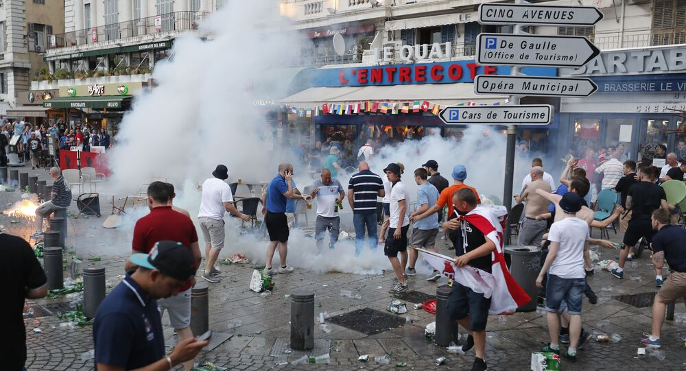 French police use tear gas against England supporters in downtown Marseille, France, Friday, June 10, 2016