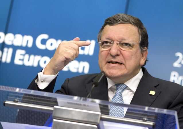 European Commission President Jose Manuel Barroso speaks during a media conference after an EU summit at the EU Council building in Brussels, on Friday, Oct. 24, 2014.