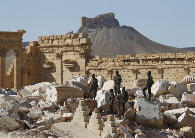 Syrian army soldiers stand on the ruins of the Temple of Bel in the historic city of Palmyra, in Homs Governorate (File)