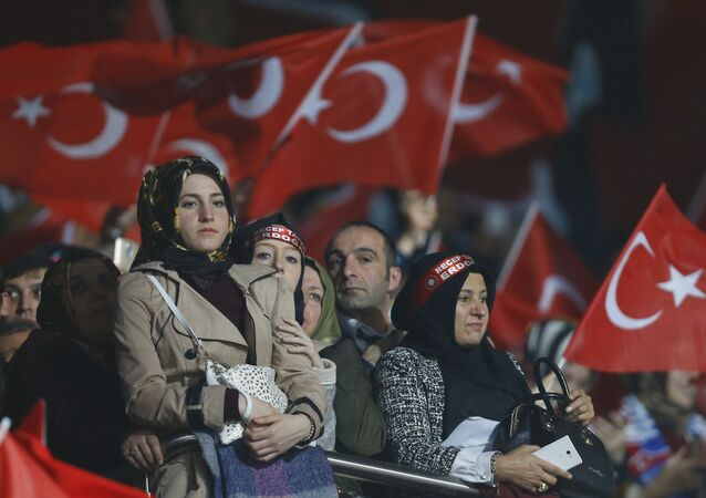 Supporters of the ruling AK Party wave Turkish flags during a campaign meeting for the April 16 constitutional referendum, in Ankara, Turkey, February 25, 2017.