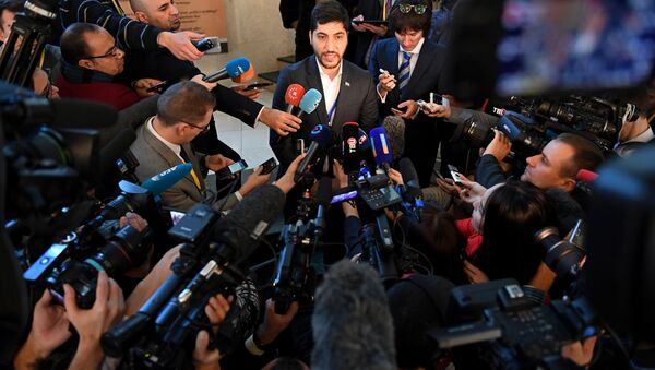 A member of the rebel delegation Osama Abu Zeid speaks to the media during the second day of Syria peace talks at Astana's Rixos President Hotel on January 24, 2017 - Sputnik International