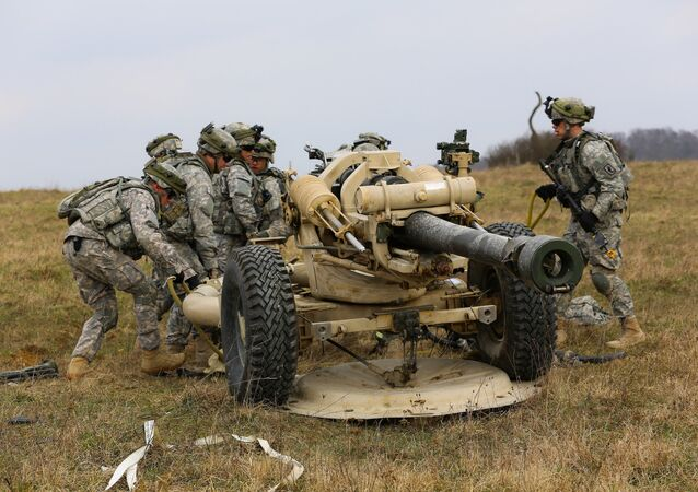 U.S. Soldiers assigned to Bravo Battery, 4th Battalion (Airborne), 319th Airborne Field Artillery Regiment, 173rd Airborne Brigade Combat team set up an M119 A2 Howitzer during a mission rehearsal exercise (MRE) at the Joint Multinational Readiness Center in Hohenfels, Germany, March 17, 2014