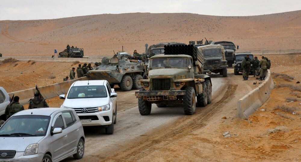 Syrian regime fighters take position as they advance to retake the ancient city of Palmyra, from Daesh on March 2, 2017