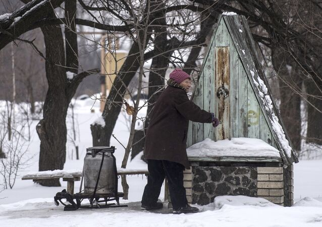 A woman gets water from a well in Avdiivka, eastern Ukraine, Thursday, Feb. 2, 2017