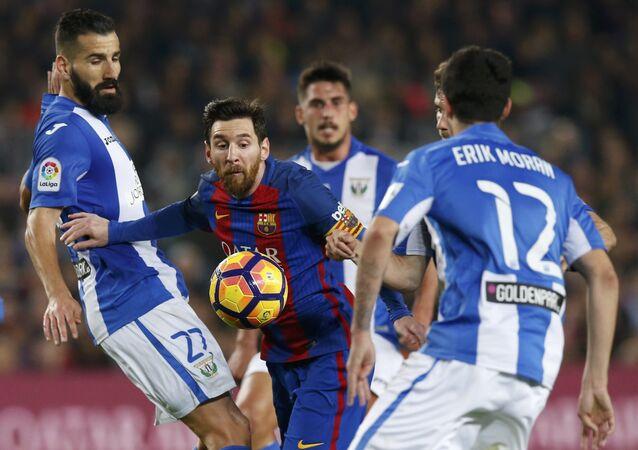 Football Soccer - Barcelona v Leganes - Spanish La Liga Santander - Camp Nou stadium, Barcelona, Spain - 19/02/17 - Barcelona's Lionel Messi in action against Leganes' Dimitris Siovas.