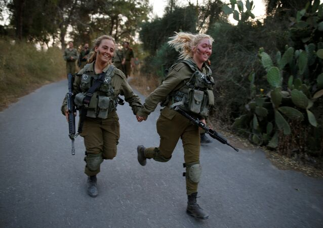 Israeli soldiers of the Search and Rescue brigade take part in a training session in Ben Shemen forest, near the city of Modi'in