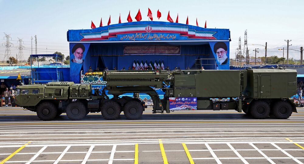 In front of the portraits of supreme leader Ayatollah Ali Khamenei, right, and late revolutionary founder Ayatollah Khomeini, left, a long-range, S-300 missile system is displayed by Iran's army during a military parade marking the 36th anniversary of Iraq's 1980 invasion of Iran, in front of the shrine of late revolutionary founder Ayatollah Khomeini, just outside Tehran, Iran