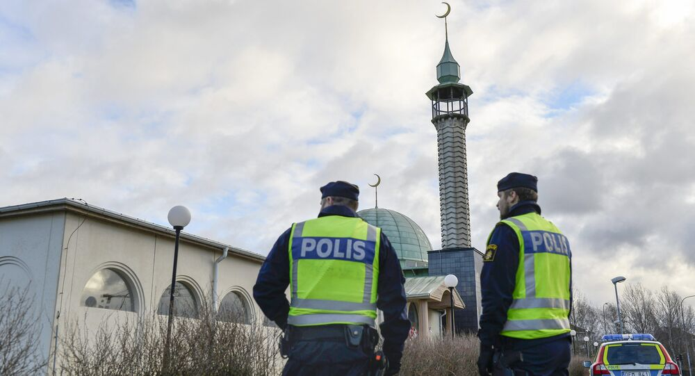 Two policemen stand outside a mosque in Uppsala, Sweden