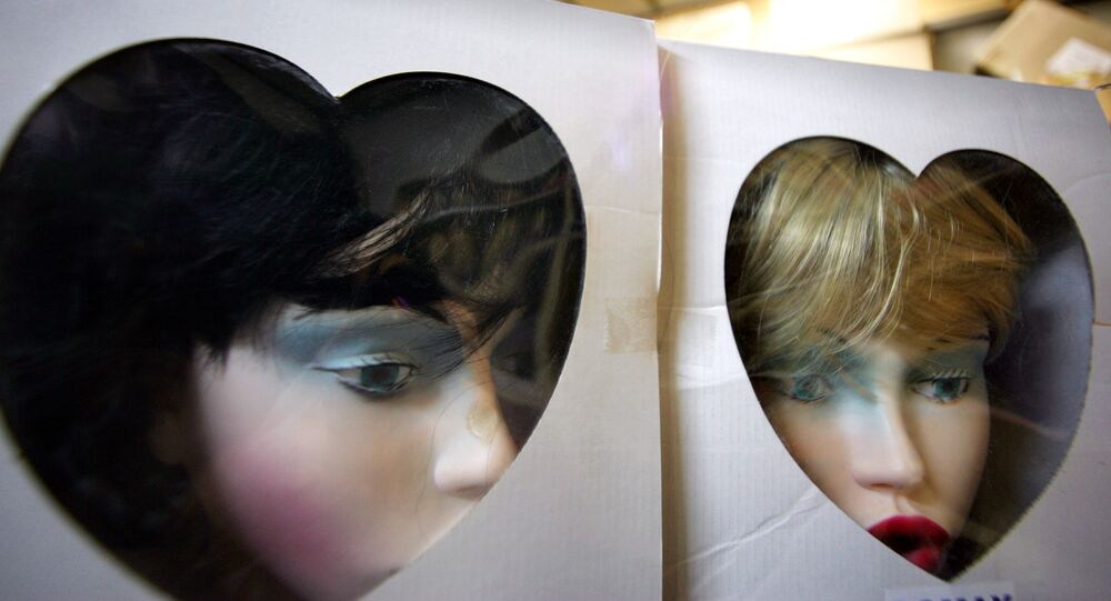 View of the heads which completed the making of latex-made adult dolls ready for shipment on an assembly line of the Domax company in Courcelles les lens, Northern France