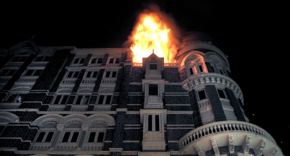Fire engulfs the top floor of the Taj Mahal hotel, site of one of the shootouts with terrorists in Mumbai.