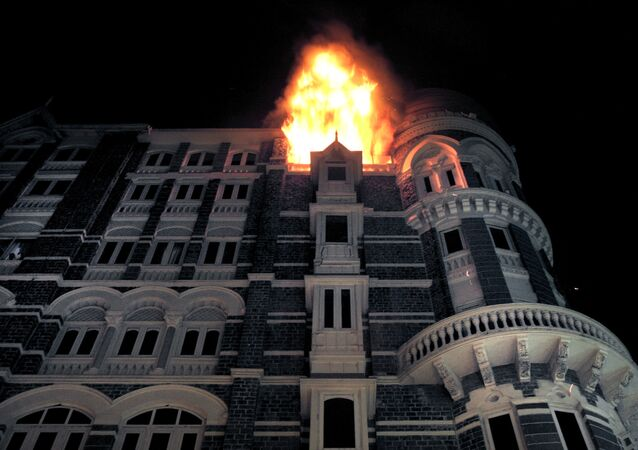 Fire engulfs the top floor of the Taj Mahal hotel, site of one of the shootouts with terrorists in Mumbai on late November 26, 2008.